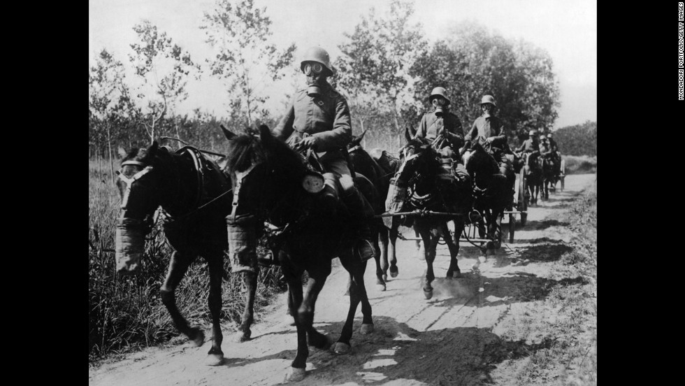 A German cavalry unit with both horses and soldiers wearing gas masks advances during the Second Battle of the Aisne at Soissons, France, in June 1918.