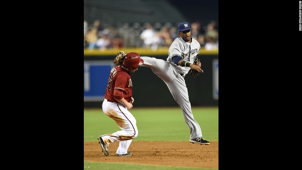 Jean Segura of the Milwaukee Brewers kicks Miguel Montero of the Arizona Diamondbacks in the head while turning a double play during the sixth inning of their game in Phoenix on Wednesday, June 18.