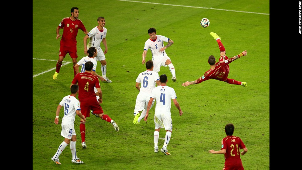 "Sergio Ramos of Spain performs an overhead kick during a World Cup match against Chile on Wednesday, June 18, in Rio de Janeiro. Chile won 2-0, making Spain -- which won the last World Cup -- <a href=""http://www.cnn.com/2014/06/18/sport/football/spain-chile-world-cup-football/index.html"">the first team to be eliminated</a> from this year's tournament."