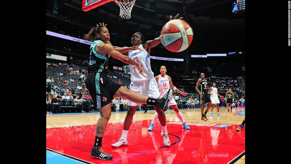 Avery Warley-Talbert of the New York Liberty has her pass blocked by Aneika Henry of the Atlanta Dream on Friday, June 20, in Atlanta. The Dream won 85-64.