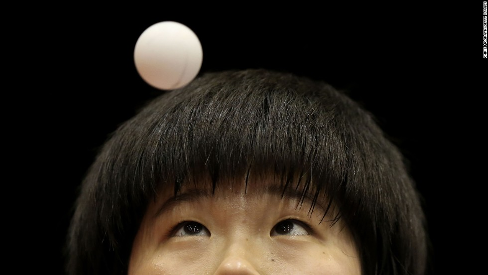 In table tennis, Lee Dasom of South Korea serves against Hitomi Sato of Japan during the 2014 ITTF World Tour Japan Open in Yokohama, Japan, on Friday, June 20.