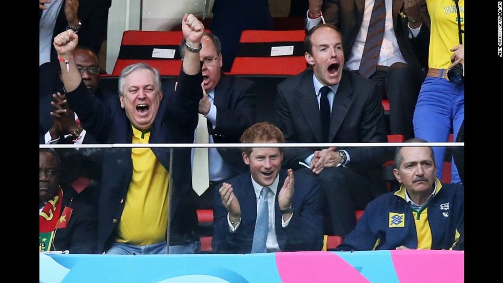 Prince Harry is seen in the stands celebrating Brazil's first goal shot by Neymar.