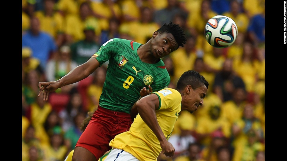 Cameroon forward Benjamin Moukandjo, left, and Brazil midfielder Luiz Gustavo vie for the ball.