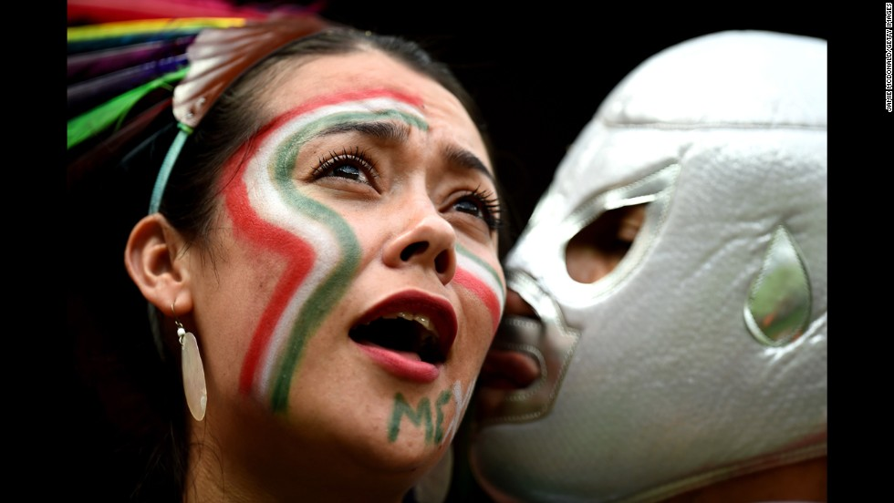 A Mexico fan receives a kiss during the match against Croatia.