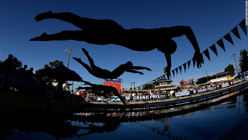 John Murray, top, and Brad Tandy dive in for the start of the men's 50-meter freestyle final during the 2014 Arena Grand Prix in Santa Clara, California, on Saturday, June 21.