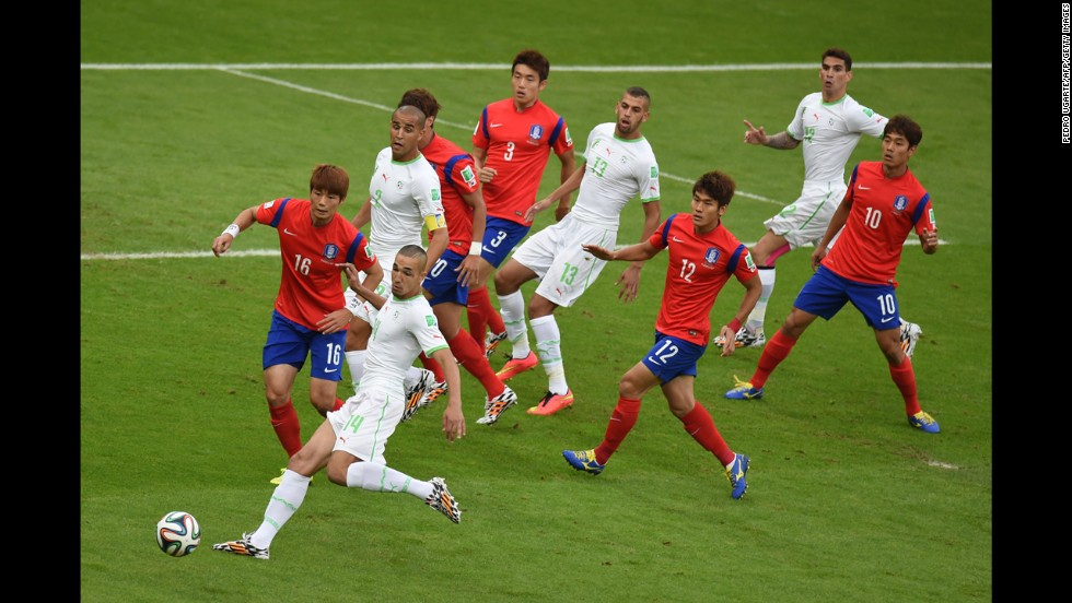 "South Korean midfielder Ki Sung-yueng, front left, fights for the ball with Algeria's midfielder Nabil Bentaleb during <a href=""http://www.cnn.com/2014/06/22/sport/football/world-cup-belgium-russia-algeria-south-korea/index.html"">a World Cup match</a> in Porto Alegre, Brazil, on Sunday, June 22. Algeria won 4-2."