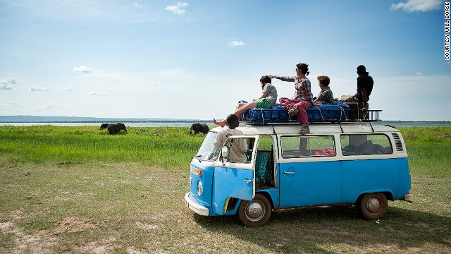 Tourists watch elephants from their Kombi in Murchison Falls National Park.
