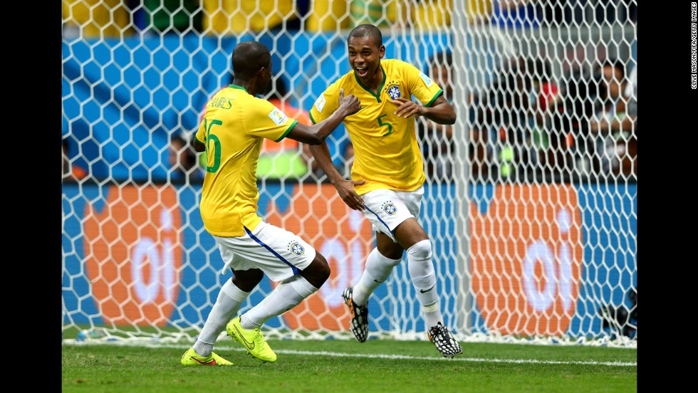 Fernandinho, right, of Brazil celebrates scoring his team's fourth goal with teammate Ramires.
