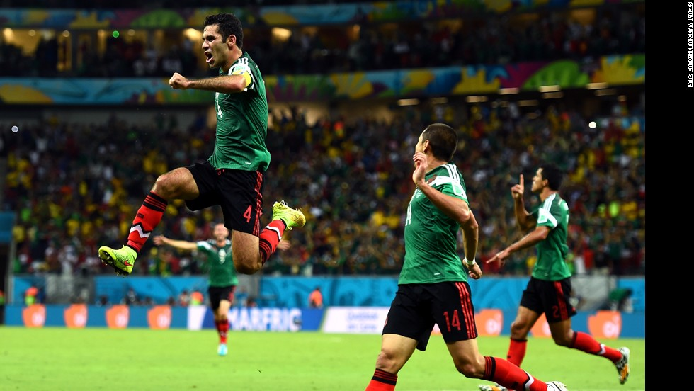 Rafael Marquez, left, of Mexico celebrates scoring his team's first goal with teammate Javier Hernandez.
