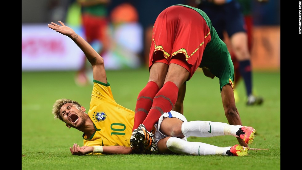 Joel Matip, left, of Cameroon collides with Neymar of Brazil.