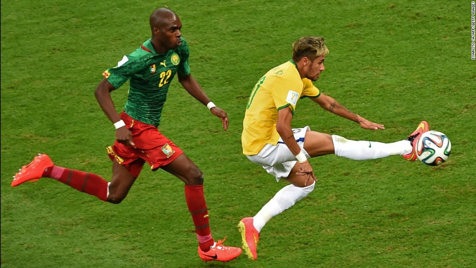 Cameroon defender Allan Nyom, left, and Brazil forward Neymar compete for the ball.