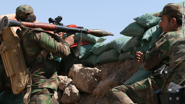 Caption:Iraqi Kurdish forces take position near Taza Khormato as they fight jihadist militants from the Islamic State of Iraq and the Levant (ISIL) positioned five kilometers away in Bashir, 20 kms south of Kirkuk, on June 23, 2014. US Secretary of State John Kerry vowed Monday that the United States would provide 'intense' support to Iraq to help it battle a militant offensive. AFP PHOTO/KARIM SAHIB (Photo credit should read KARIM SAHIB/AFP/Getty Images)
