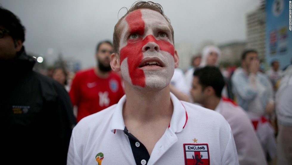 An England supporter in Rio de Janeiro watches a video broadcast as Uruguay scored its first goal against England on Thursday, June 19. Uruguay scored a late goal to win 2-1.