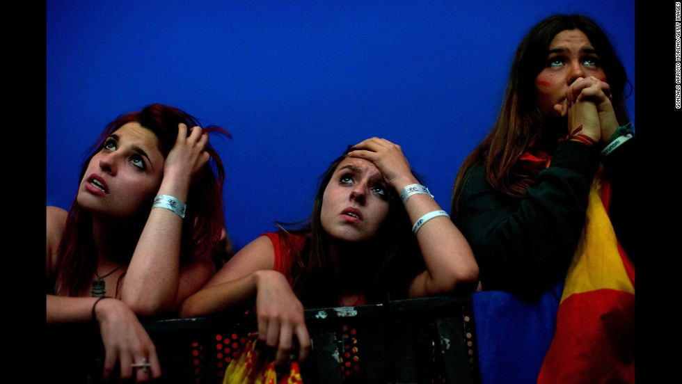 Supporters of Spain watch in Madrid as their team loses 2-0 to Chile on June 18.