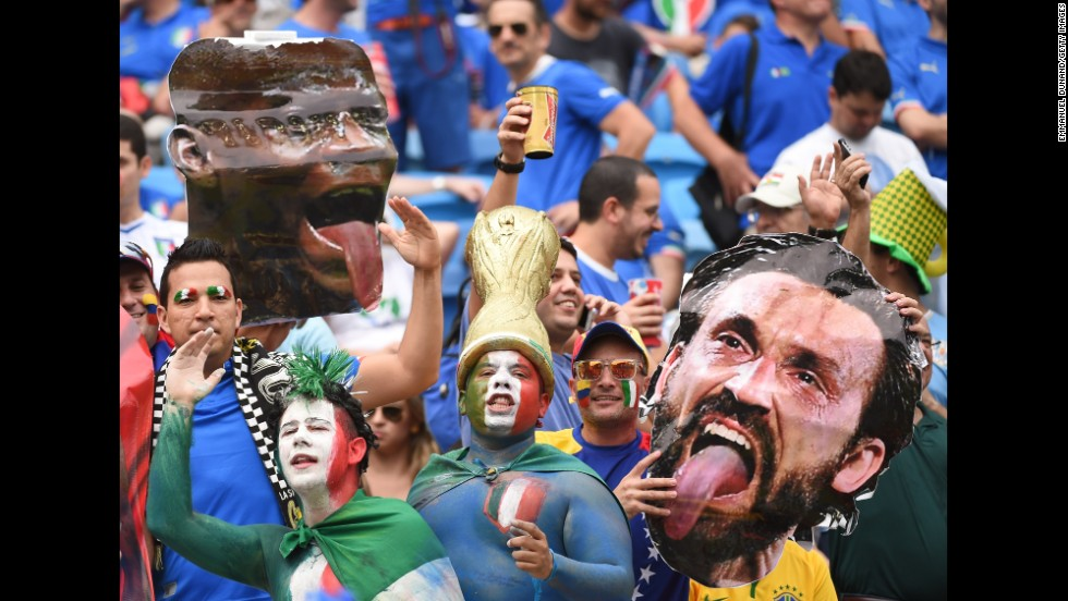 Italy fans hold up cardboard cutouts of forward Mario Balotelli, left, and midfielder Andrea Pirlo.