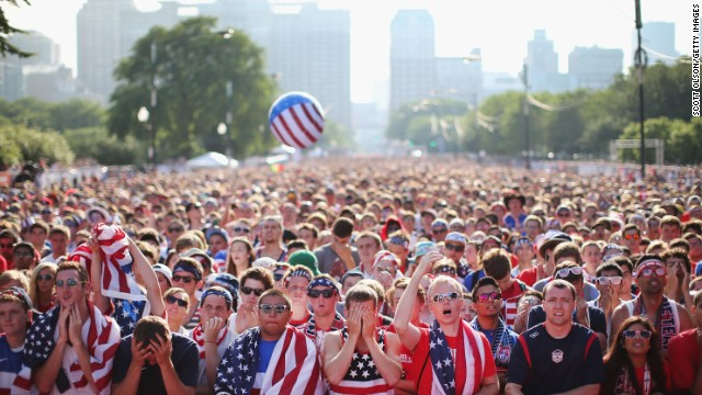 CHICAGO, IL - JUNE 22: Fans gather in Grant Park to watch the U.S. play Portugal in a Group G World Cup soccer match on June 22, 2014 in Chicago, Illinois. Fans were turned away from the free event after a 10,000-person capacity was reached. (Photo by Scott Olson/Getty Images)
