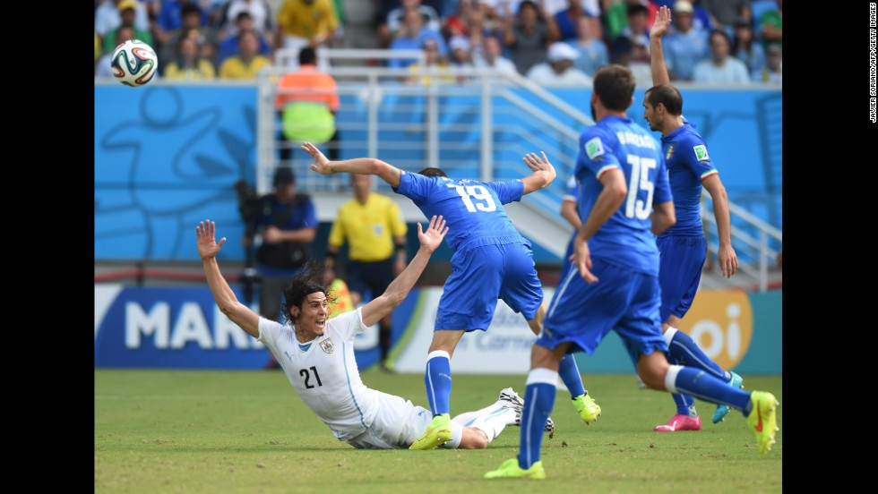Uruguay's Edinson Cavani, left, is fouled by Italy's Leonardo Bonucci in the penalty area.