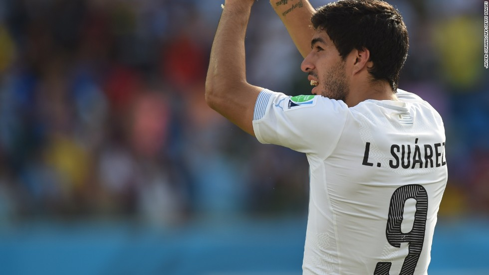 Suarez celebrates as Uruguay booked their place in the last 16 thanks to a 1-0 win, secured by Diego Godin's header.