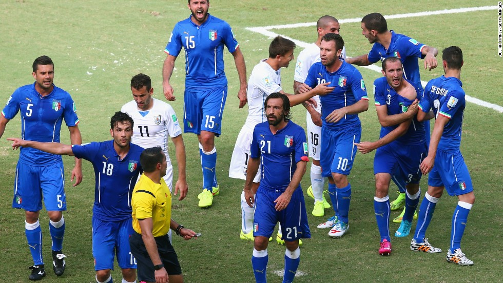 "Players from both sides react after the incident. Chiellini later told Rai TV: ""It was ridiculous not to send Suarez off. It is clear."""