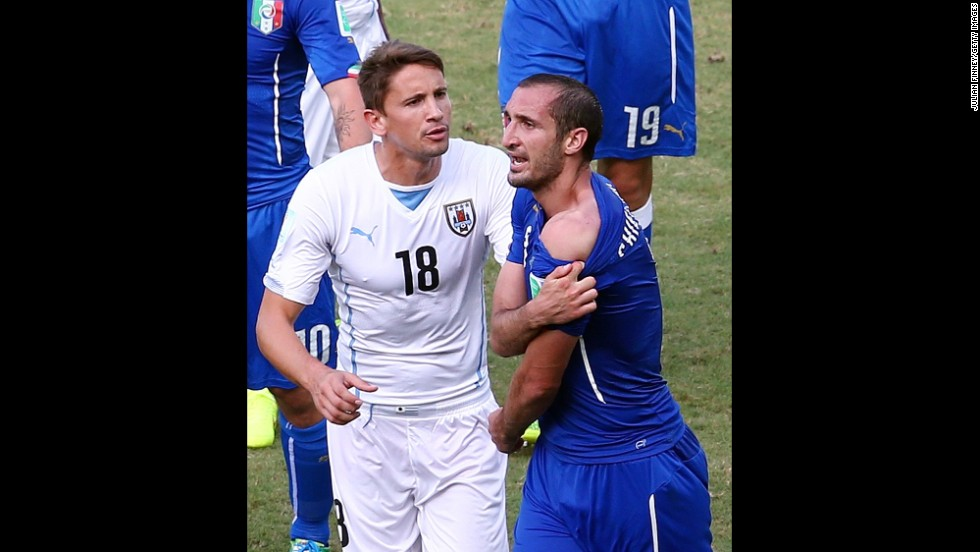 Giorgio Chiellini of Italy pulls down his shirt after a clash with Luis Suarez (not pictured), contending that the Uruguay player bit him.