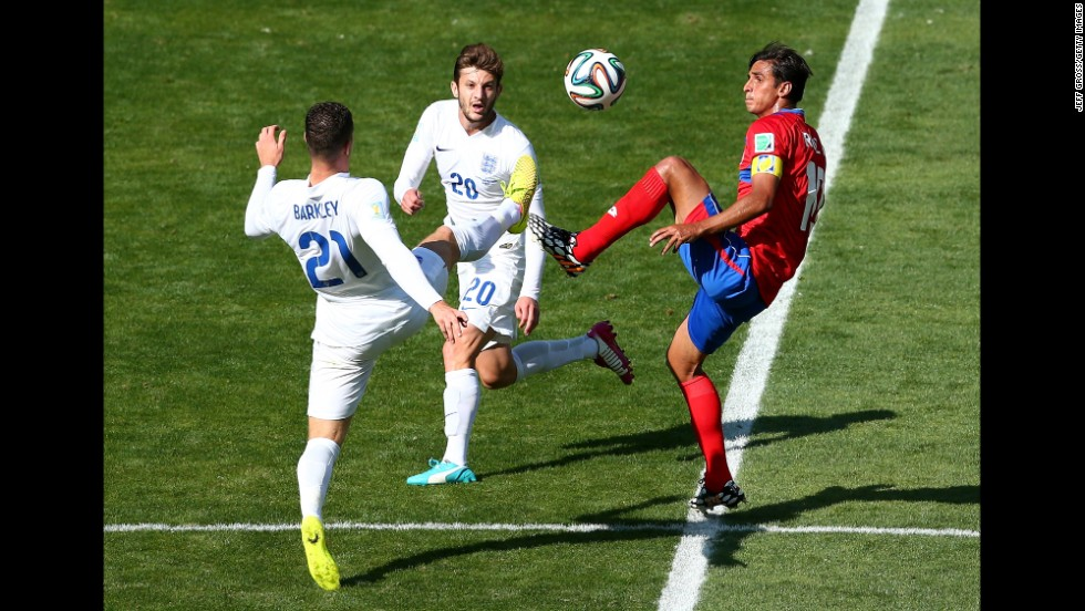 Bryan Ruiz of Costa Rica competes for the ball with Ross Barkley, left, and Adam Lallana of England.