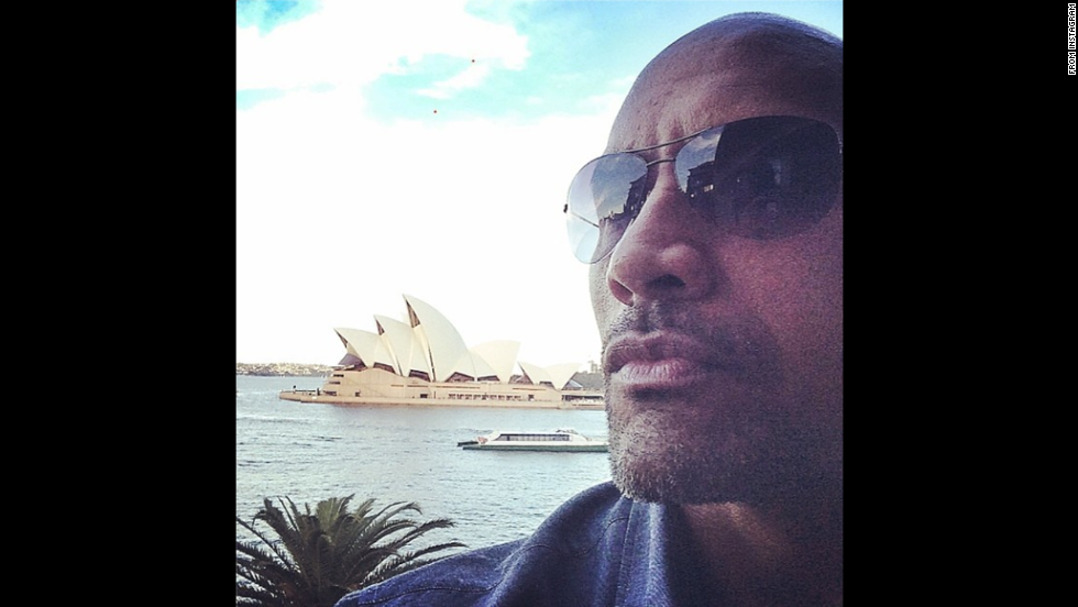 "Dwayne ""The Rock"" Johnson <a href=""http://instagram.com/p/pap2F8ohzF/"" target=""_blank"">posted a selfie</a> to Instagram after arriving in Sydney, Australia, on Thursday, June 19, to present a preview of his upcoming film ""Hercules."" ""Wheels just touched down.. Missed you Sydney,"" he said. ""Always good to be back. Let's have some fun tonight ... But first let me rock out my selfie game. #OperaHouseBoogie"""