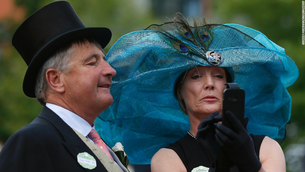 Peter Foster and Gillian Kirby take a selfie on the second day of the Royal Ascot horse racing event in Ascot, England, on Wednesday, June 18.