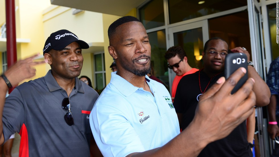 Jamie Foxx, center, and Jawan Strader take a selfie at the Celebrity Golf Tournament during the 10th annual Irie Weekend in Miami Beach, Florida, on Friday, June 20 .