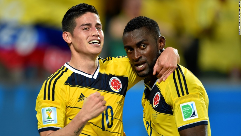 Jackson Martinez of Colombia, right, celebrates with his teammate Rodriguez after scoring his team's third goal against Japan.