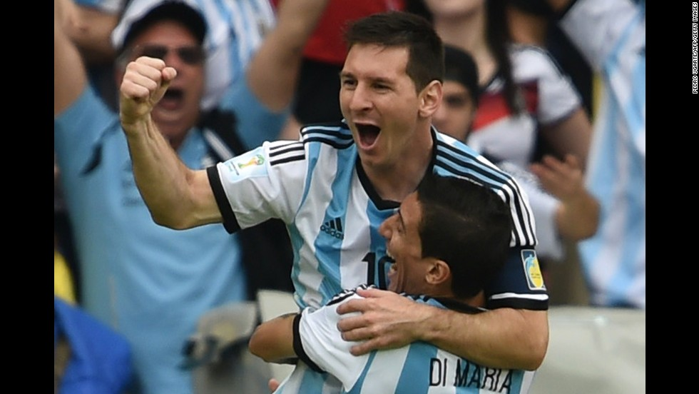 Messi, left, celebrates with his teammate Angel Di Maria, after scoring his team's first goal against Nigeria.