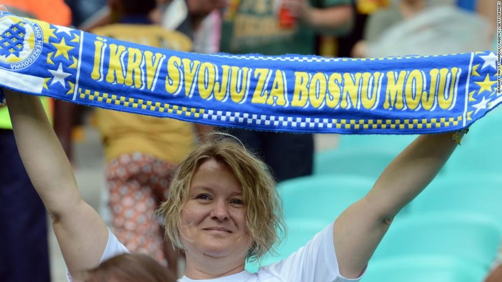 Bosnia-Herzegovina soccer fans wait for the start of the match against Iran.
