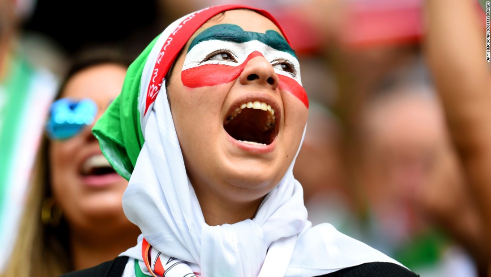 An Iran fan cheers.