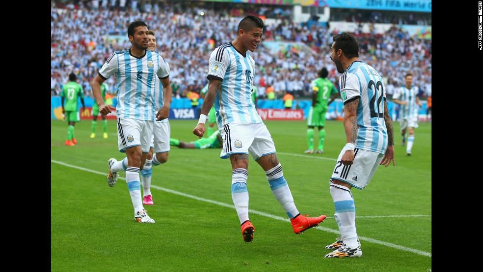 Marcos Rojo of Argentina, center, celebrates scoring his team's third goal with Ezequiel Garay, left and Ezequiel Lavezzi.