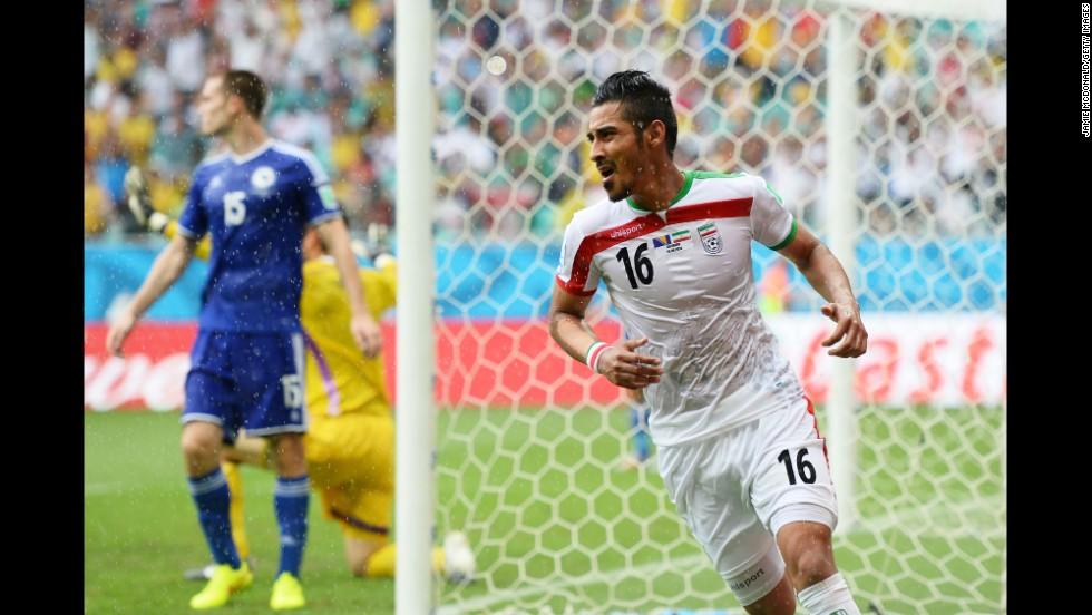 Reza Ghoochannejhad of Iran celebrates scoring his team's first goal.