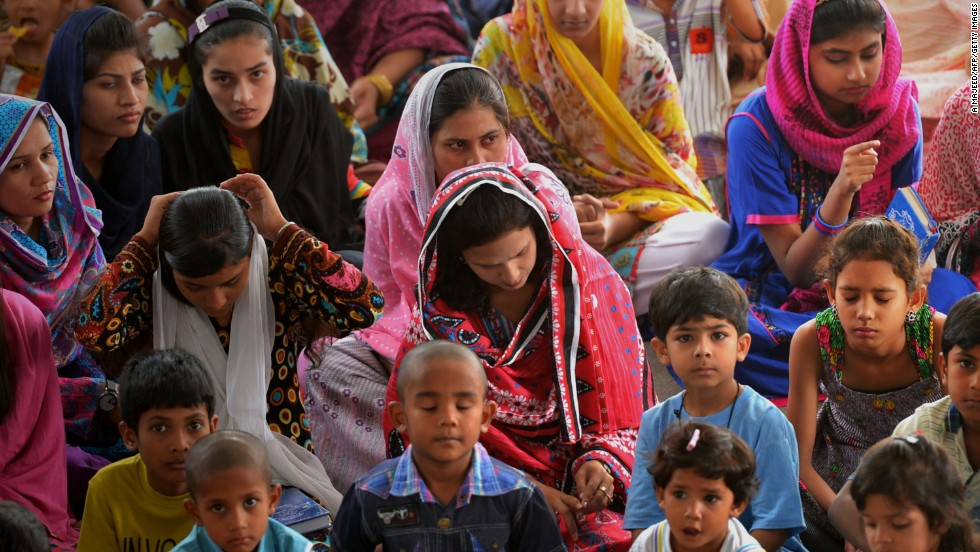 Displaced Pakistani Christians attend a church service. Most of the people fleeing are women and children. The men have stayed at home to protect their homes and livestock.