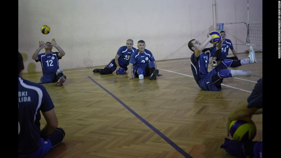Land mine victims take part in a sitting volley ball match at the Doboj Gym Hall in Zenica, Bosnia.