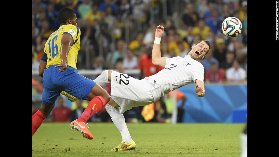 France's Morgan Schneiderlin, right, is challenged by Ecuador's Antonio Valencia.