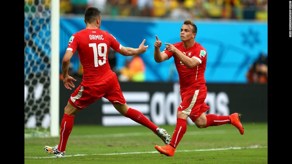 Xherdan Shaqiri, right, of Switzerland celebrates scoring his team's second goal against Honduras with teammate Josip Drmic.