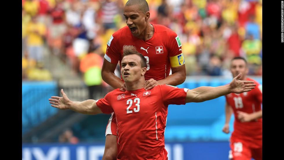 Switzerland midfielder Shaqiri, left, celebrates with midfielder and captain Goekhan Inler after a score.
