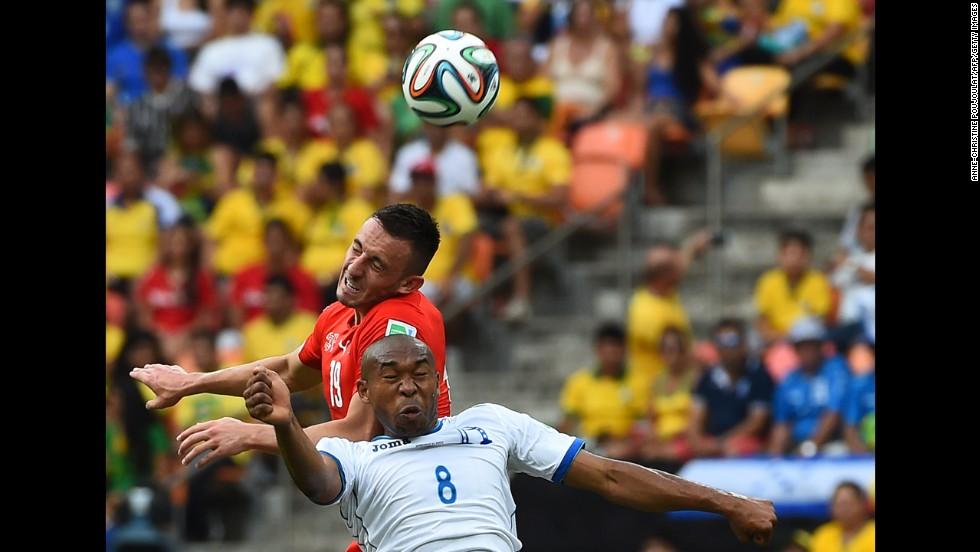 Switzerland forward Josip Drmic, top, vies with Honduras midfielder Wilson Palacios.