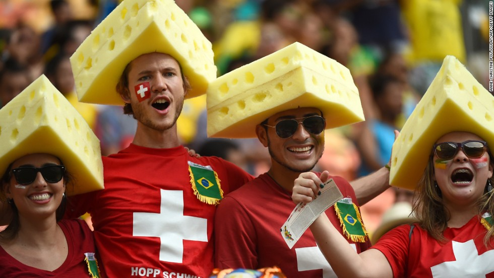 Swiss fans cheer for their team before the start of the match between Honduras and Switzerland at the Amazonia Arena.