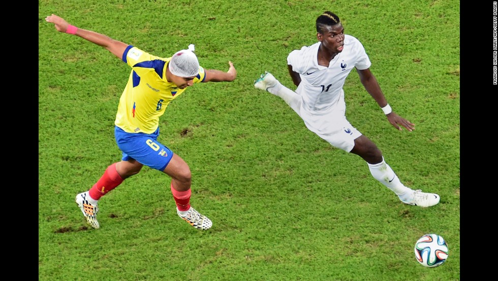 Ecuador's Cristhian Noboa, left, challenges France's Paul Pogba during a World Cup match in Rio de Janeiro on Wednesday, June 25. The game ended 0-0.