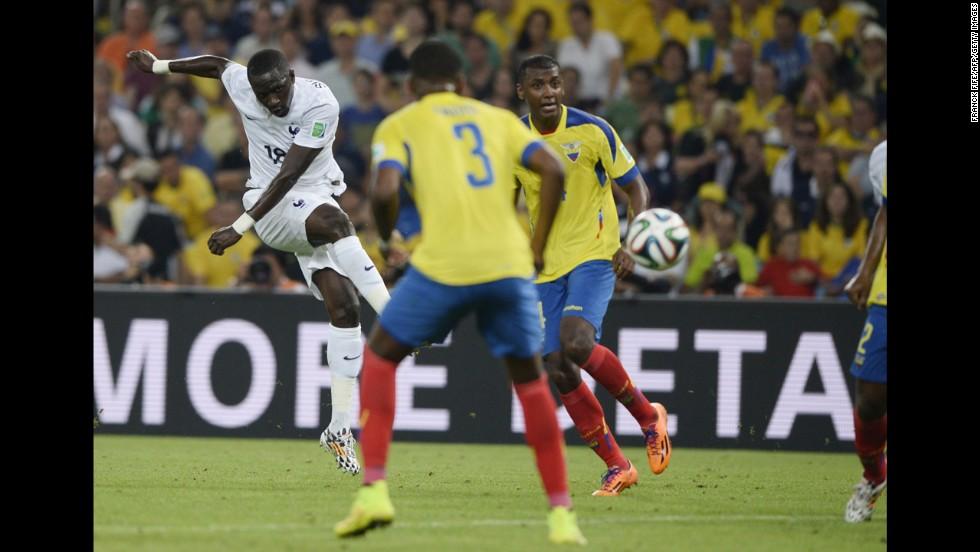 France's Moussa Sissoko, left, kicks the ball.
