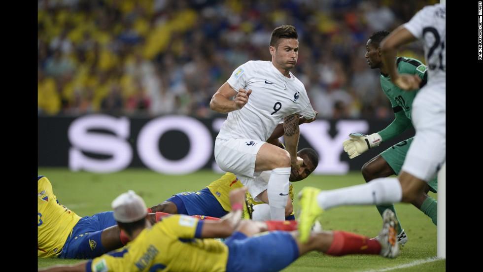 France's Olivier Giroud, center misses a goal attempt against Ecuador.