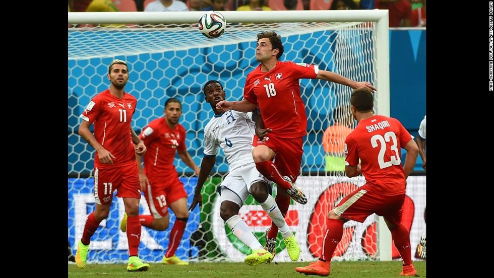 Honduras' Juan Carlos Garcia, third from left, challenges Switzerland's Admir Mehmedi.