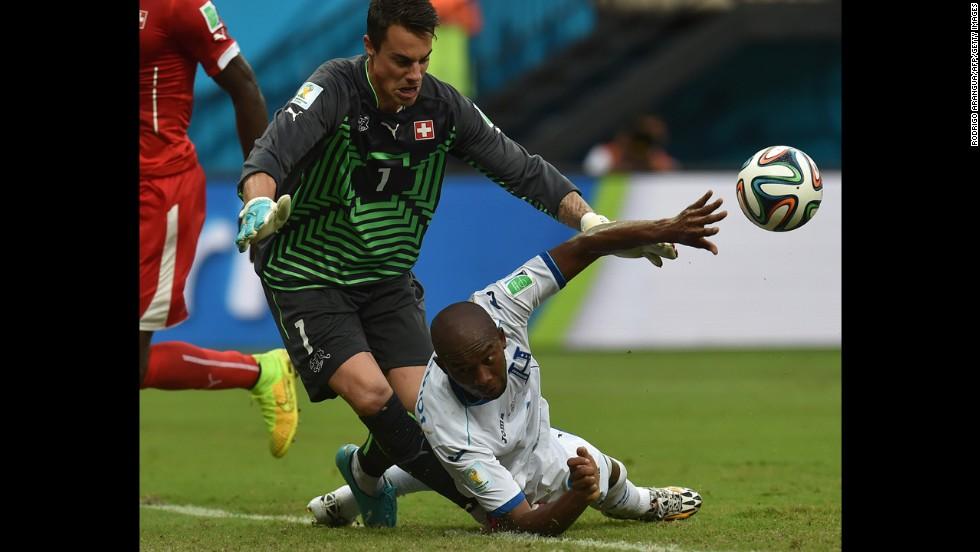 Switzerland's goalkeeper Diego Benaglio, left, challenges Switzerland's Goekhan Inler.