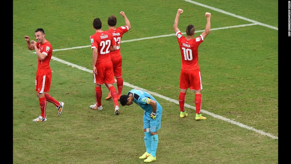Honduras' goalkeeper Noel Valladares, front, reacts as Switzerland celebrates its third goal.