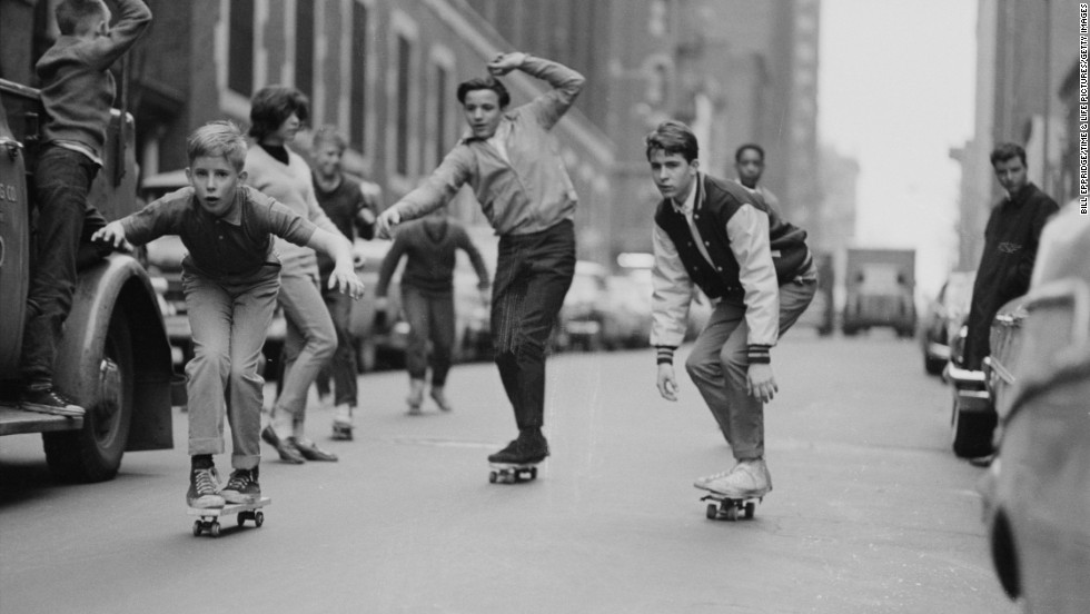 Skateboards had just started to take off in 1963, after onetime California lifeguard Larry Stevenson perfected a wheeled version of the surfboard. During the summer of 1964, the boards spread around the United States. Here, boys skate past cars on the streets of New York in 1965.