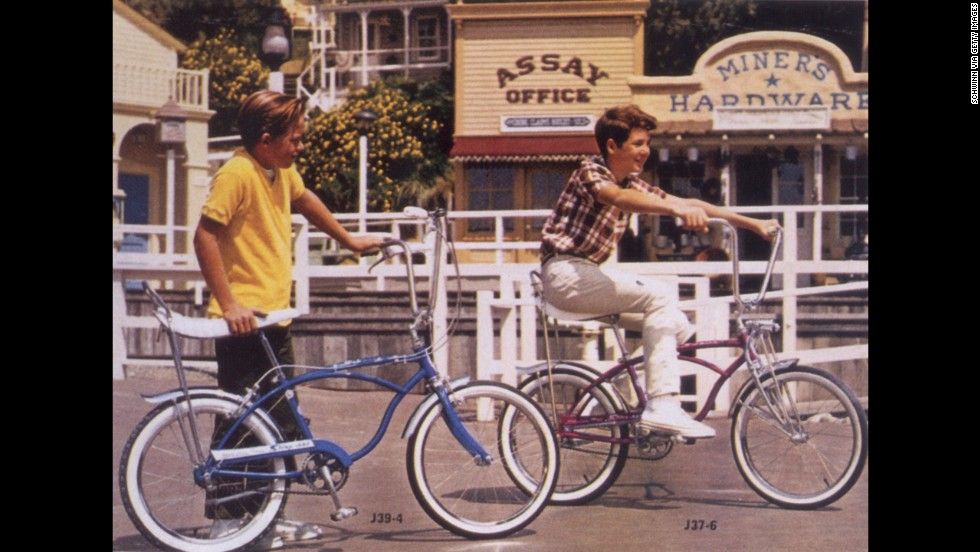 The Schwinn Sting-Ray, a motorcycle-inspired bicycle, debuted in 1963 and first appeared in Schwinn's catalog in 1964. Its banana seat and deep handlebars, shown here in 1966, became a fast favorite among young cyclists.