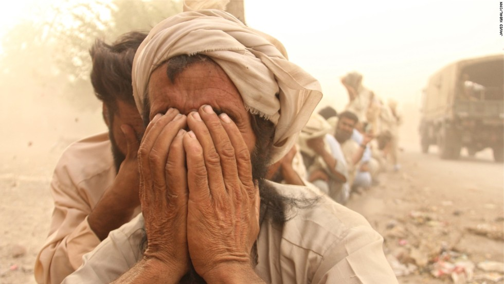 In Bannu, a dust storm raised havoc at the city's largest food distribution point for people displaced by regional fighting.